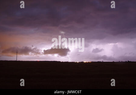 Lightning on heavy and dark clouds. Storm sky. Stock Photo