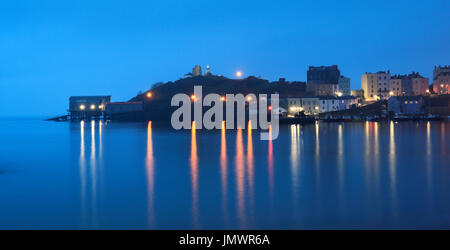 Sea mist rolls in over Castle Hill nad the harbour , Tenby, Pembrokeshire, Wales, Europe - Stock Photo