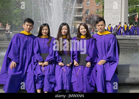 An NYU graduate in her cap and gown poses in the fountain in Stock ...