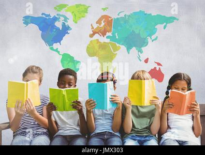 Digital composite of Group of children sitting and reading in front of colorful world map - Stock Photo