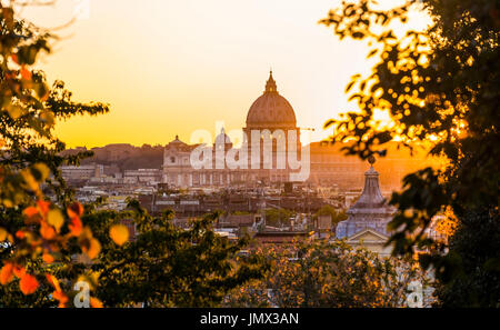 st peter´s basilica at dusk seen from pincian hill in villa borghese gardens, rome, lazio, italy - Stock Photo
