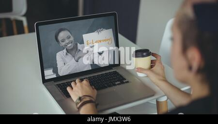 Digital composite of Woman using a computer with e-learning information in the screen - Stock Photo