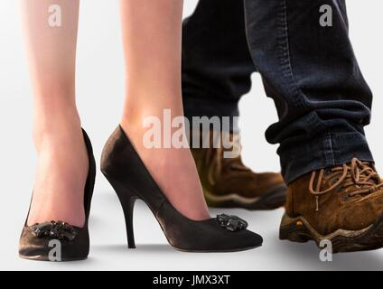 Digital composite of Woman and man's feet with high heels and hiking shoes - Stock Photo