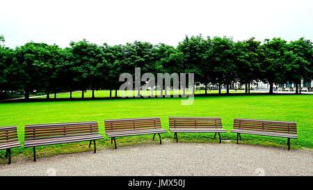 Wooden Benches at a park in Kurhaus Baden-Baden, Baden-Baden, Baden-Württemberg , Germany - Stock Photo
