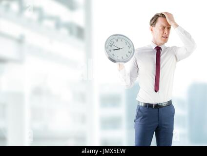 Digital composite of man holding clock in front of buildings - Stock Photo