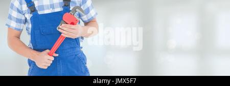 Digital composite of Mechanic man holding a wrench - Stock Photo