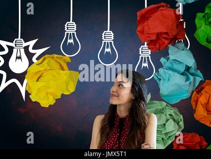 Digital composite of Woman standing next to light bulbs with crumpled paper balls - Stock Photo