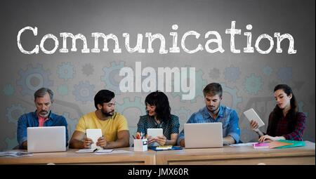 Digital composite of Communication text and Group of people on devices in front of cog wheels settings graphics - Stock Photo