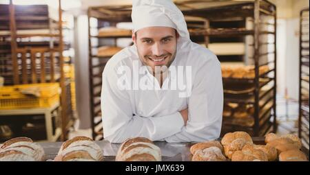 Digital composite of Happy small business owner man making bread - Stock Photo