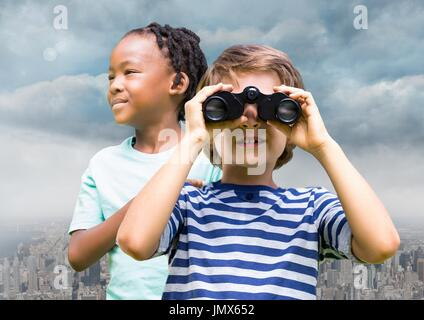 Digital composite of Boys with binoculars over city - Stock Photo