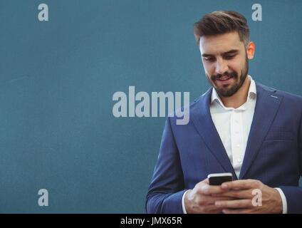Digital composite of Man on phone with blue background - Stock Photo