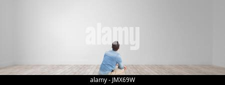 Digital composite of Man looking at a wide blank - Stock Photo