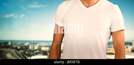 Midsection of model against white background against cityscape against sky - Stock Photo