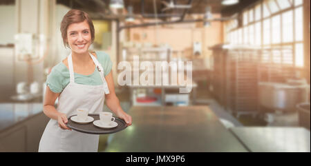 Waitress giving cup of coffee  against no one in the room - Stock Photo