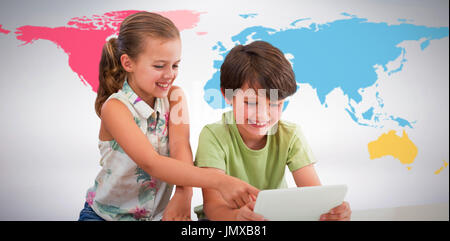 Boy with sister using digital tablet against grey background - Stock Photo