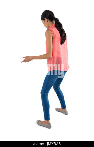 Attractive woman standing on white background - Stock Photo