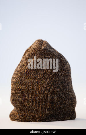 Close-up of wooly hat against white background - Stock Photo