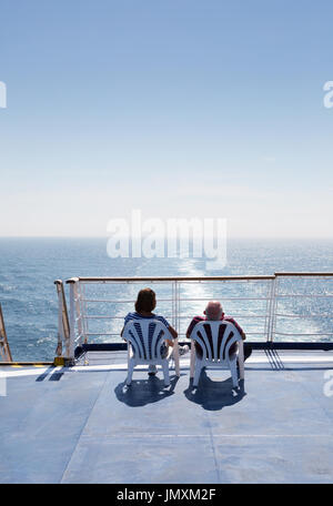 Couple cruising on a cross channel  ferry,  Brittany Ferry 'Bretagne', Brittany Ferries, from Portsmouth UK to St - Stock Photo