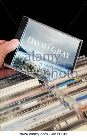 Life in Slow Motion, 2005  David Gray CD being chosen from among rows of other CD's, Dorset, England - Stock Photo