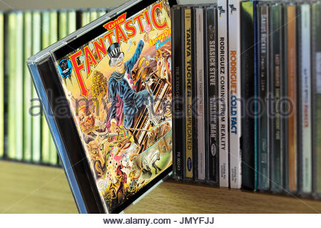 Captain Fantastic And The Dirt Brown Cowboy, Elton John CD pulled out from among other CD's on a shelf, Dorset, - Stock Photo
