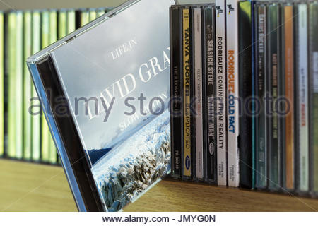 Life in Slow Motion, 2005  David Gray CD pulled out from among other CD's on a shelf, Dorset, England - Stock Photo