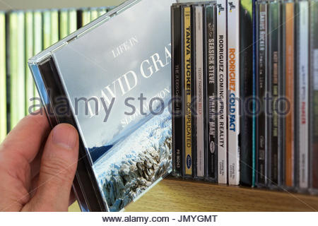 Life in Slow Motion, 2005  David Gray CD being chosen from a shelf of other CD's, Dorset, England - Stock Photo