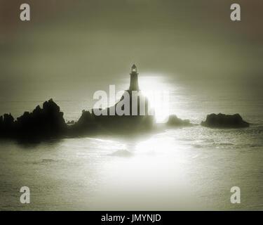 GB - JERSEY: La Corbiere Lighthouse at sunset