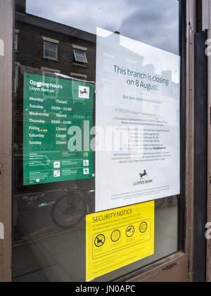 Lloyds Bank Branch Closure notice on the door of the branch - Stock Photo