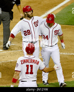 Washington right fielder Jayson Werth (28) congratulates center fielder Bryce Harper (34) after Harper's fifth inning two run home run against the New York Mets at Nationals Park in Washington, D.C. on Friday, August 17, 2012.  Nationals third baseman Ryan Zimmerman (11) waits to congratulate Harper..Credit: Ron Sachs / CNP.(RESTRICTION: NO New York or New Jersey Newspapers or newspapers within a 75 mile radius of New York City)