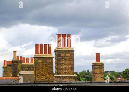 Chimneys against a cloudy London sky - Stock Photo