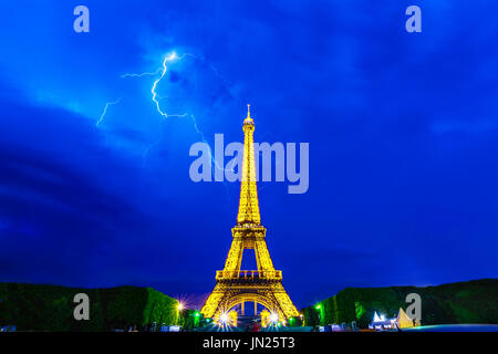 Paris, France - June 8th, 2014: Thunderstorms behind Eiffel Tower illuminated at night-during Roland Garros tour. - Stock Photo