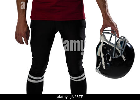 Midsection of football holding helmet against white background - Stock Photo