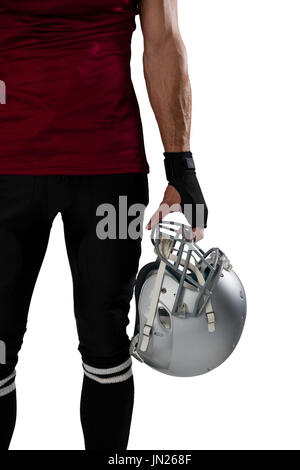 Cropped image of football player holding helmet against white background - Stock Photo
