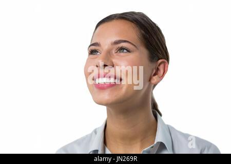 Beautiful female executive smiling against white background - Stock Photo