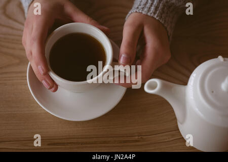 Close-up of woman holding cup of coffee - Stock Photo