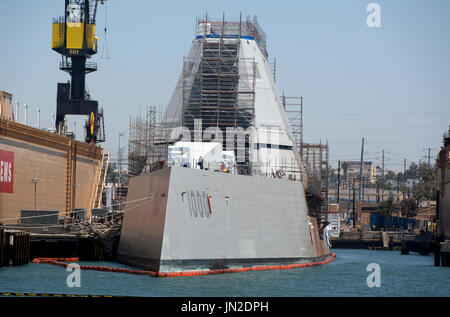 The stealth guided missile destroyer, USS Zumwalt, docked in San Diego Bay, California. - Stock Photo