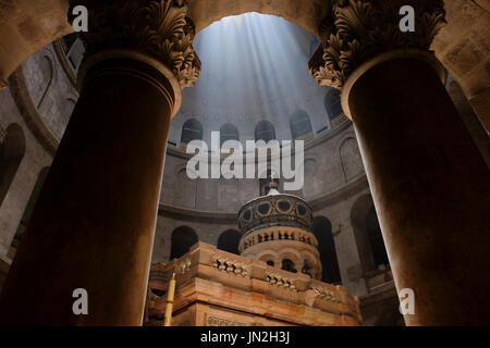 Ray of sunlight breaks through the ceiling over the Edicule, the shrine that tradition says houses the cave where - Stock Photo
