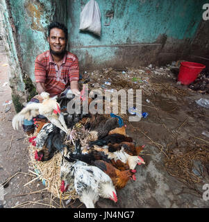Chicken vendor in Old Dhaka, Bangladesh - Stock Photo