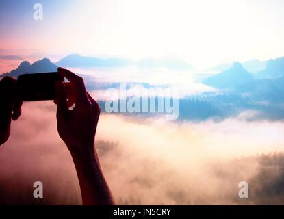 Smart phone mobile photography of sunny rocky mountains landscape - Stock Photo