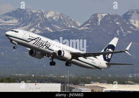 ALASKA AIRLINES 737 CLIMBING OUT OF ANCHORAGE - Stock Photo