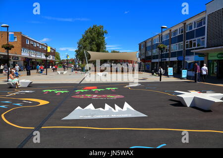 The new play area with its new protected stage area in the middle of the shopping center in Woodley town on a clear - Stock Photo