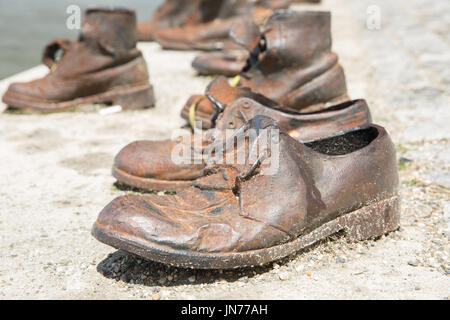 Monument to the victims of the Holocaust. Men's shoes close-up on the banks of the Danube. Budapest, Hungary - Stock Photo