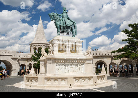 Equestrian statue of Saint Istvan and Fisherman's bastion in Budapest, Hungary - Stock Photo