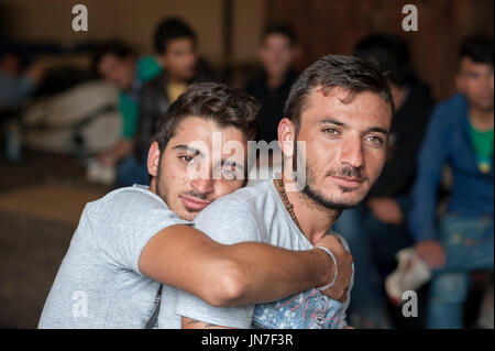 Passau, Germany - August 2, 2015: Camiran Mahmond and Rinas Ali, two friends from Syria at the registration area - Stock Photo