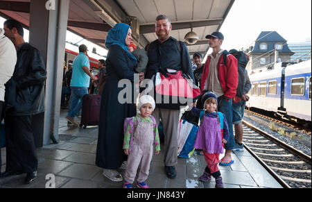 Munich, Germany -September 10th, 2015: Refugees from Syria and Afghanistan hopping on the next train at the main - Stock Photo