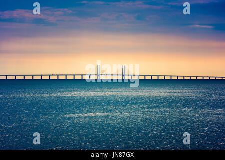 Oresund Bridge crossing the Oresund Strait, connecting Copenhagen Denmark and Malmo Sweden - Stock Photo