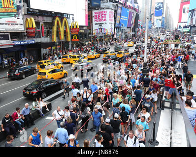 View of traffic, travelers and theater-goers on a summer day in Times Square Manhattan on July 28, 2017 in New York, - Stock Photo