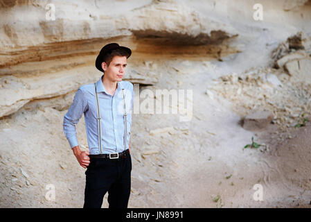 Stylish Attractive Man Stands In The Middle Of A Sand Quarry And
