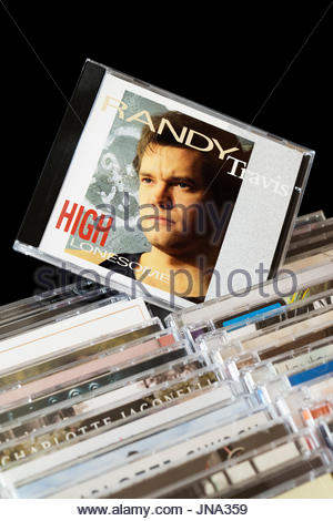 High Lonesome, Randy Travis CD pulled out from among rows of other CD's, Dorset, England - Stock Photo