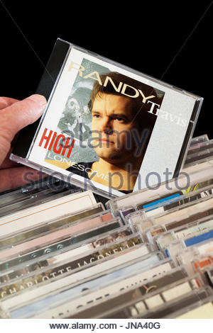 High Lonesome, Randy Travis CD being chosen from among rows of other CD's, Dorset, England - Stock Photo
